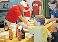The 2015 Historical and Archeological Society of Fort Riley Ice Cream Social was Aug. 15 at the Historic Custer House from 3 to 5 p.m.  The event included build-your-own ice cream sundaes, apple pie tasting from Libby Custer's own recipe, historic dress and tours of the house.  Guests also previewed the 2015 American Flag Rag Quilt and could purchase tickets for the drawing which is to be held at the 2015 Fall Apple Day Festival Sept. 26.