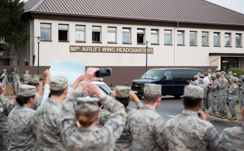 More than 500 service members and civilians line the streets of Ramstein Air Base, Germany, Aug. 24, 2015, to applaud Airman 1st Class Spencer Stone and Aleksander Skarlatos, an Army specialist in the Oregon National Guard, for their recent heroic actions in France. Stone is an ambulance service technician with the 65th Medical Operations Squadron at Lajes Field, Azores. (U.S. Air Force photo/Senior Airman Damon Kasberg)