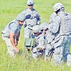Michael Fol, (left), a civilian training instructor with the U.S. Army Armament Research, Development and Engineering Center, instructs Soldiers of the 1st Bde. Eng. Bn., 1st ABCT, 1st Inf. Div., on how to properly set-up and arm the M-7 Spider Landmine July 31 at Range 7 on Fort Riley, Kansas.