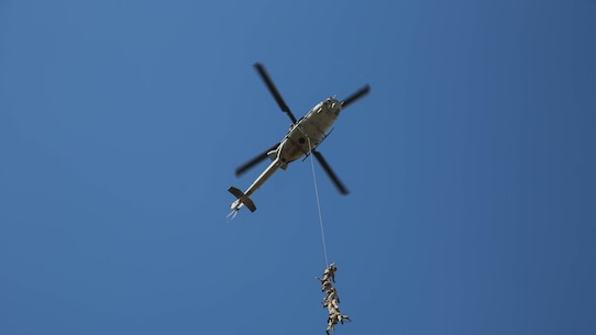 Marines from Company A, 1st Reconnaissance Battalion, 1st Marine Divison, I Marine Expeditionary Force, are suspended from a UH-1Y Huey helicopter during an exercise on Marine Corps Base Camp Pendleton, Calif., Aug. 18, 2015. Utilizing both fast-roping and Special Patrol Insertion and Extraction rigging methods, the purpose of the training exercise was to integrate operational coordination between the I MEF Ground Combat Element and Air Combat Element.