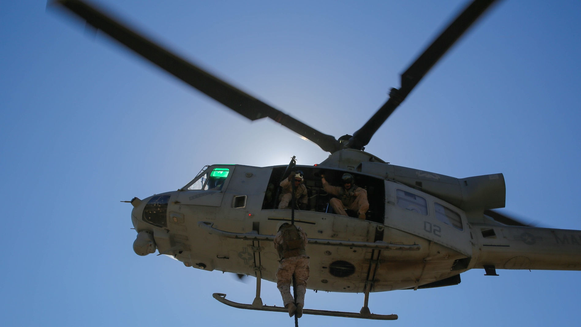A Marine with Company A, 1st Reconnaissance Battalion, 1st Marine Division, I Marine Expeditionary Force, fast-ropes out of a UH-1Y Huey helicopter on Marine Corps Base Camp Pendleton, Calif., Aug. 18, 2015. Utilizing both fast-roping and Special Patrol Insertion and Extraction rigging methods, the purpose of the training exercise was to integrate operational coordination between the I MEF Ground Combat Element and Air Combat Element.