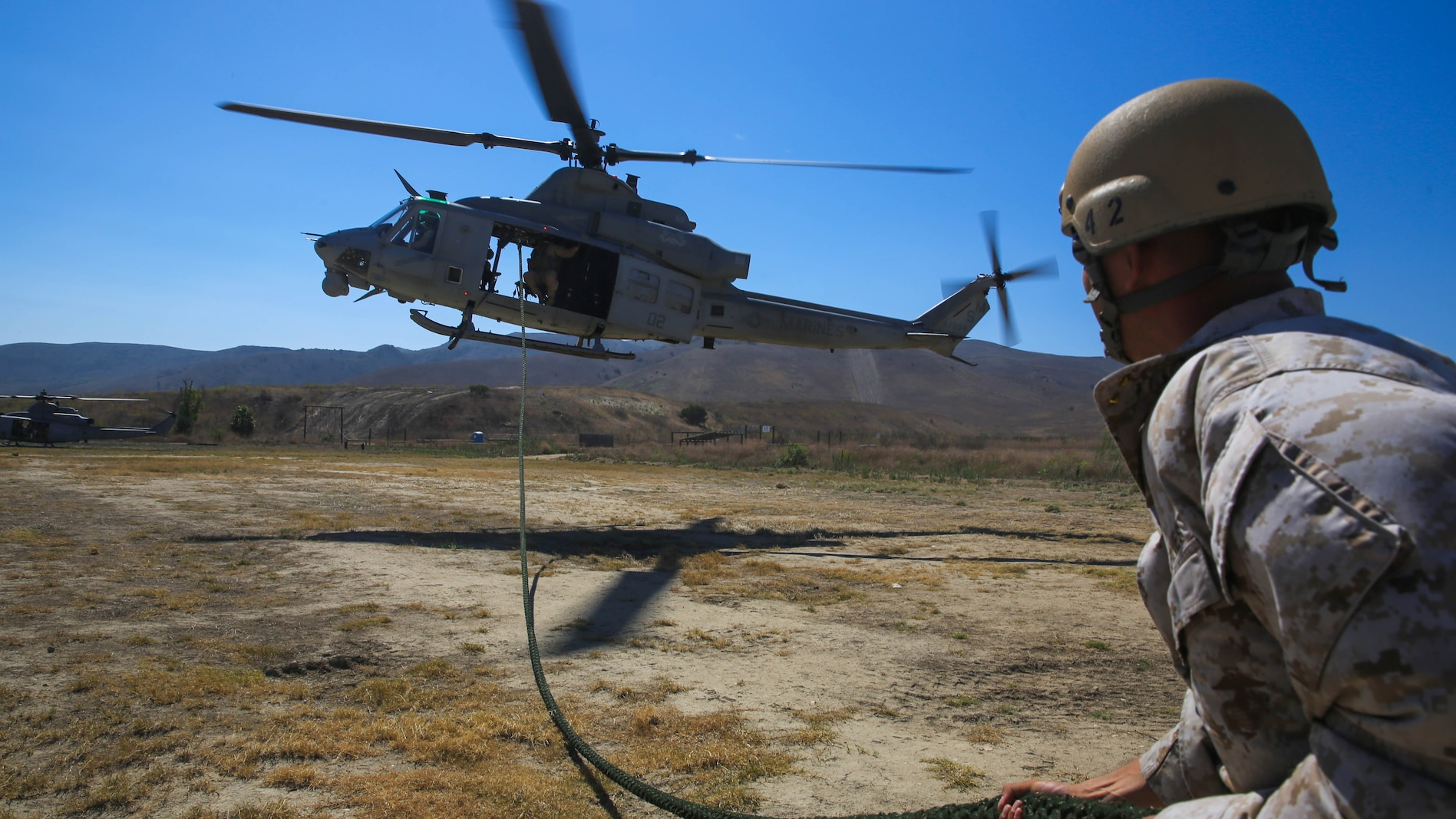 Mechanicsburg, Pa., native Gunnery Sgt. Daniel Young, a platoon sergeant with Company A, 1st Reconnaissance Battalion, 1st Marine Division, I Marine Expeditionary Force, draws a fast-roping line out from underneath a UH-1Y Huey helicopter during a training exercise on Marine Corps Base Camp Pendleton, Calif., Aug. 18, 2015. Utilizing both fast-roping and Special Patrol Insertion and Extraction rigging methods, the purpose of the training exercise was to integrate operational coordination between the I MEF Ground Combat Element and Air Combat Element.