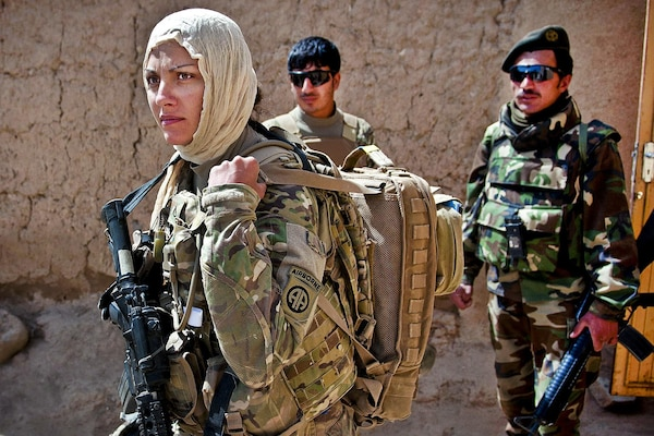 U.S. Army Pfc. Kristina Batty dons a headscarf to meet with female Afghan villagers in Ghazni province, Afghanistan, May 5, 2012.    Battym a medic assigned to the 82nd Airborne Division's 1st Brigade Combat Team, is joining Female Engagement Team members to discover what females of the village need. U.S. Army photo by Sgt. Michael J. MacLeod
