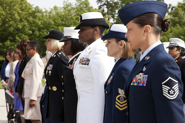 Service members and civilian guests attend the 17th annual wreath-laying ceremony at the Women In Military Service For America Memorial in Arlington Va., May 20, 2014.