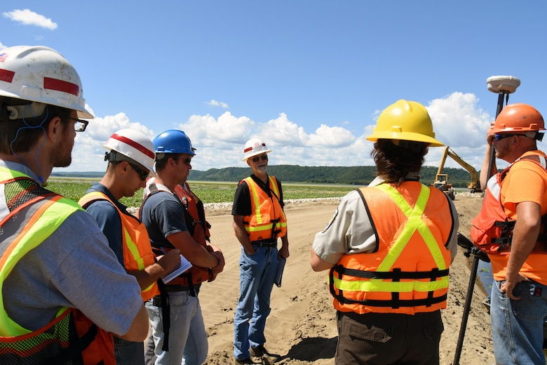 Resident engineer Scott Baker, center, talks with the contractor and project partners Aug. 11, 2015, during the weekly progress meeting for the Harper's Slough project. The Harper's Slough Habitat Rehabilitation and Enhancement Project, located within the Upper Mississippi River National Wildlife and Fish Refuge, was planned and designed under the authority of the Upper Mississippi River Restoration Program. It will protect five existing islands and construct an additional seven islands using material from the backwater and main channel. The program emphasizes habitat rehabilitation and enhancement projects and long-term resource monitoring. Project component includes dredging backwater areas and channels, constructing dikes, creating and stabilizing islands and controlling side channel flows and water levels. Once the project is completed, the project will be turned over to the U.S. Fish and Wildlife Service, who manages the refuge.