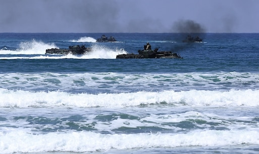 Marines with Headquarters and Service Company, 3d Assault Amphibian Battalion, 1st Marine Division, maneuver their Amphibious Assault Vehicle to the shore aboard Marine Corps Base Camp Pendleton, Calif., after exiting the well deck of amphibious transport dock ship USS New Orleans (LPD18), during a training exercise, Aug. 22, 2015. The purpose of the training was to provide surf qualification training for the battalion's crew members. (U.S. Marine Corps photo by Staff Sgt. Bobbie A. Curtis)