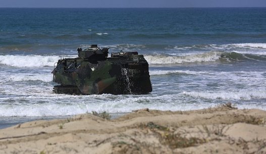 Marines with Company A, 3d Assault Amphibian Battalion, 1st Marine Division, maneuver their Amphibious Assault Vehicle to the shore aboard Marine Corps Base Camp Pendleton, Calif., after exiting the well deck of amphibious transport dock ship USS New Orleans (LPD18), during a training exercise, Aug. 22, 2015.   The purpose of the training was to provide surf qualification training for the battalion's crew members. (U.S. Marine Corps photo by Staff Sgt. Bobbie A. Curtis)
