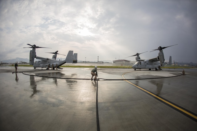 Marines with Marine Aerial Refueler Transport Squadron(VMGR) 152 refuel MV-22B Osprey tiltrotor aircrafts with Marine Medium Tiltrotor Squadron 262, during air delivery ground refueling training aboard Marine Corps Air Station Iwakuni, Japan, Aug. 20, 2015. The KC-130J aircraft is capable of carrying more than 12,000 gallons of fuel and simultaneously refueling two aircraft at 300 gallons a minute. This ability, along with many others, makes VMGR-152 and their aircraft an important asset to Marine Corps' aviation.