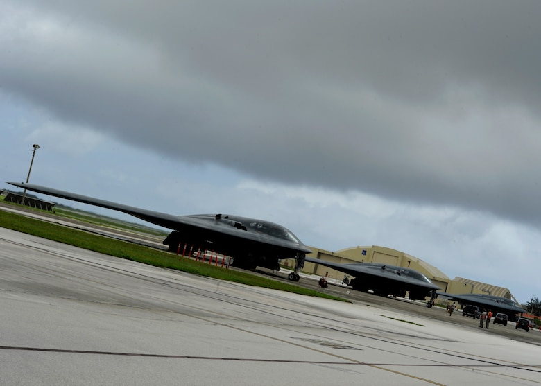 Three U.S. Air Force B-2 Spirits from Whiteman Air Force Base, Missouri, are parked on the flightline at Andersen Air Force Base, Guam, Aug. 17, 2015. Strategic bombers remain an effective means of providing extended deterrence against potential adversaries, while providing assurance to Allies. (U.S. Air Force photo by Senior Airman Joseph A. Pagán Jr./Released)