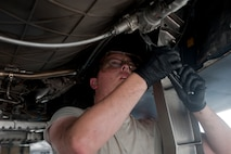 Airman 1st Class Thomas Overley, 757th Aircraft Maintenance Squadron Strike Aircraft Maintenance Unit aerospace propulsion specialist, performs an engine borescope inspection on an F-15E Strike Eagle on the flightline at Nellis Air Force Base, Nev., Aug. 19, 2015. Aerospace propulsions specialists help ensure that the aircraft's engine is in operational condition. (U.S. Air Force photo by Airman 1st Class Mikaley Towle)