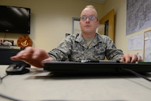 U.S. Air Force Staff Sgt. Matthew Ison, the 354th Operations Support Squadron noncommissioned officer in-charge of current operations, sends out a schedule Aug. 19, 2015, at Eielson Air Force Base, Alaska. Ison prepares airspace route schedules every day, which allow for the most effective training from each participating unit. (U.S. Air Force photo by Senior Airman Ashley Nicole Taylor/Released)