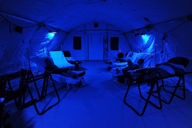 Airmen with simulated injuries rest in an En-Route Patient Staging System during an exercise on Kadena Air Base, Japan, Aug. 18, 2015. An ERPSS can be up and running in a matter of hours and is only used during times of war or other contingencies. It is a temporary facility erected to house patients and allow medical professionals to care for them before they are medically evacuated to a better-equipped facility in a safer area. (U.S. Air Force photo by Airman 1st Class Zade C. Vadnais)