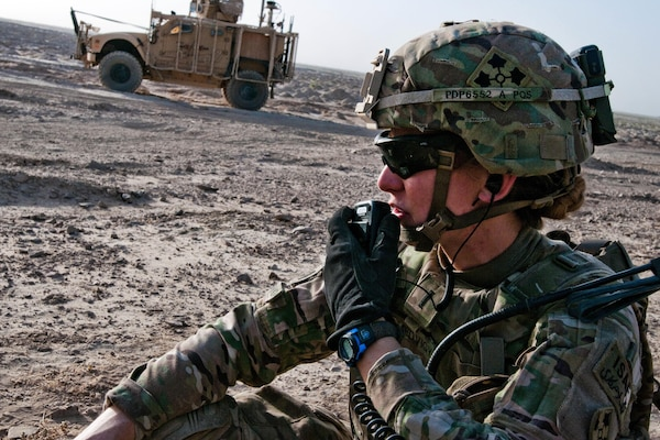 U.S. Army 1st Lt. Elyse Ping Medvigy conducts a call-for-fire during an artillery shoot south of Kandahar Airfield, Afghanistan, Aug. 22, 2014. Medvigy, a fire support officer assigned to the 4th Infantry Division's Company D, 1st Battalion, 12th Infantry Regiment, 4th Infantry Brigade Combat Team, is the first female company fire support officer to serve in an infantry brigade combat team supporting Operation Enduring Freedom. U.S. Army photo by Staff Sgt. Whitney Houston