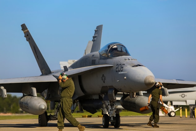 Marines prepare an F/A-18C Hornet to take off from Marine Corps Air Station Beaufort during Exercise Sentry Savannah 2015, Aug 21. Sentry Savannah is a joint service air operation hosted by the Savannah Combat Readiness Training Center, Ga. The Marines are with Marine Fighter Attack Squadron 115, Marine Aircraft Group 31.