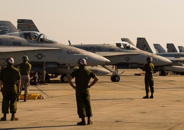 Marines prepare F/A-18C Hornets to take off from Marine Corps Air Station Beaufort to during Exercise Sentry Savannah 2015, Aug 21. Several squadrons from Marine Corps Air Station Beaufort, including Marine Fighter Attack Squadron 115 flew training exercises for Sentry Savannah. The Marines are with Marine Fighter Attack Squadron 115, Marine Aircraft Group 31.