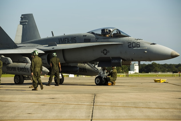 Marines prepare an F/A-18C Hornet to take off from Marine Corps Air Station Beaufort to participate in Sentry Savannah, Aug 21. The hornet flew a joint mission with the Air Force simulating enemy aircraft in a large force exercise for the Marines are with Marine Fighter Attack Squadron 115, Marine Aircraft Group 31.