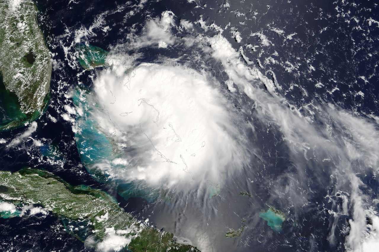 This Aug. 25, 2005, satellite image shows inbound Hurricane Katrina. The storm moved slowly, enabling heavy rains to linger longer over one area, the National Hurricane Center warned. The center forecast 6-10 inches of rain over Florida and the Bahamas, and up to 15 inches in some regions. Courtesy photo
