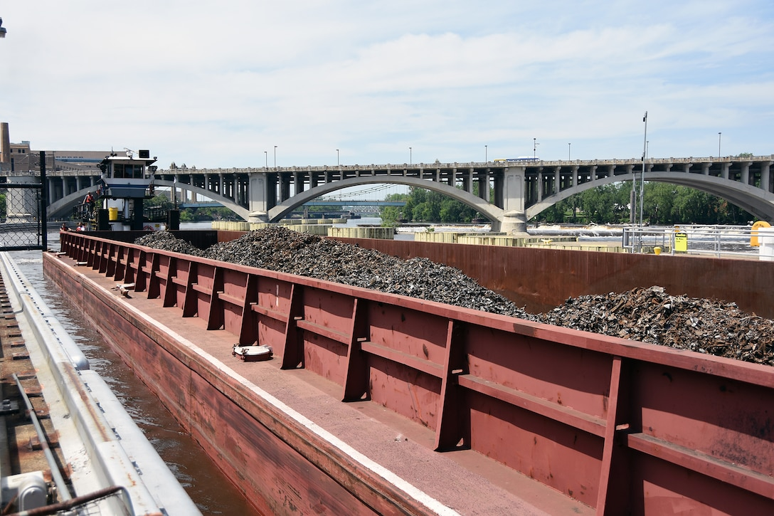 Upper River Services' Motor Vessel Becky Sue locks through Upper St. Anthony Falls lock in downtown Minneapolis at 2:45 p.m. on June 9, 2015, with two barges loaded with scrap metal. This marked the final lockage by a commercial tow at the lock.  The Water Resources Reform and Development Act of 2014 directed the Corps to close the lock to navigation by June 10, 2015.