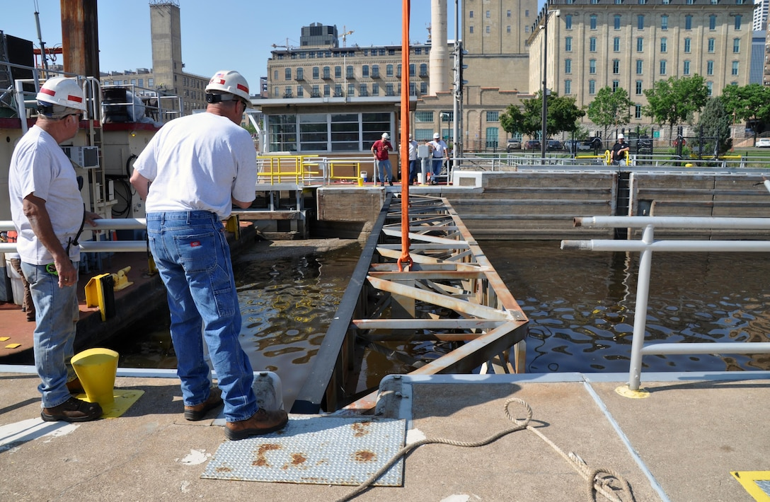 St. Paul District's Fountain City Service Base maintenance and repair crews from Fountain City, Wisconsin, use the Crane Barge Hauser June 10, 2015, to install the bulkhead barriers at the upstream end of the lock chamber at Upper St. Anthony Falls Lock and Dam as part of the closure process. The Water Resources Reform and Development Act of 2014 directed the Corps to close the lock to navigation by June 10, 2015.