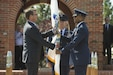 Defense Secretary Ash Carter hands the U.S. Transportation Command flag to Air Force Gen. Darren W. McDew as he assumed command during a ceremony on Scott Air Force Base, Ill., Aug. 26, 2015.