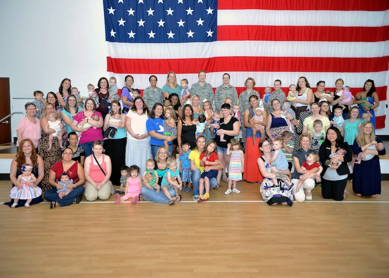People pose for a group photo August 21, 2015 on Luke Air Force Base, Arizona. Luke held its first Breastfeeding Awareness Luncheon to show support for breastfeeding and a mother's right to choose. Certificates of appreciation were handed out for mothers who are committed to breastfeeding. Prizes and food were donated to the luncheon. (U.S. Air Force photo by Senior Airman Marcy Copeland)