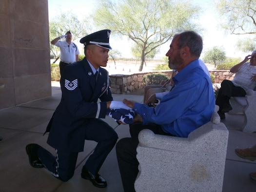 Tech. Sgt. Richard Galero, 56th Force Support Squadron Luke Air Force Base Honor Guard NCO in charge, hands off a flag during a funeral honors ceremony at the National Memorial Cemetery, Arizona 2015. Galero trains and mentors Airmen in the Base Honor Guard. Prior to Honor Guard, he was a maintenance analyst. (Courtesy Photo)