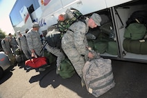 Oregon Air National Guard Airmen from the 142nd Fighter Wing and Combat Operations Group load their gear and board buses from the Portland Air National Guard Base, Ore., Aug. 25, 2015 as they prepare for firefighter training in Salem, Ore. The personnel are scheduled to report to the Department of Public Safety Standards and Training (DPSST), in Salem, Oregon to undergo firefighting training starting Wednesday, Aug. 26. DPSST officials say the additional group should complete their training by Aug. 30.   (U.S. Air National Guard photo by Tech. Sgt. John Hughel, 142nd Fighter Wing Public Affairs/Released)