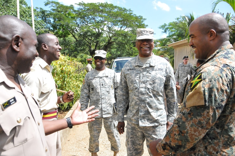 Maj. Gen. Errol Schwartz, Commanding General of the District of Columbia National Guard, speaks with members of the Jamaica Defense Force at the Moneague Training Base, Moneague, Jamaica, Aug. 19. (U.S. Air National Guard photo by Senior Airman Sumeana Leslie)