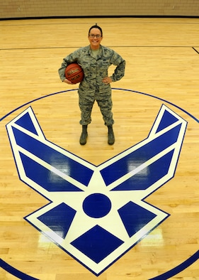 Senior Airman Aleiah Enders, 319th Force Support Squadron fitness specialist, poses at mid-court of the fitness center August 25, 2015 on Grand Forks Air Force Base, North Dakota. Enders was named the Warrior of the Week for the fourth week of August 2015. (U.S. Air Force photo by Airman 1st Class Ryan Sparks/Released)