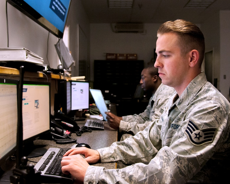 Staff Sgt. Aaron Smith and Senior Airman Joseph bates, 90th Logistics Readiness Squadron Traffic Control Function controllers, monitor computer systems, which allow them to update the 90th Missile Wing about road conditions in its missile complex, Aug. 5, 2015, on F.E. Warren Air Force Base, Wyo. TCF Airmen operate 24/7 to ensure the 90th Missile Wing has up-to-date road conditions. (U.S. Air Force photo by Senior Airman Jason Wiese)