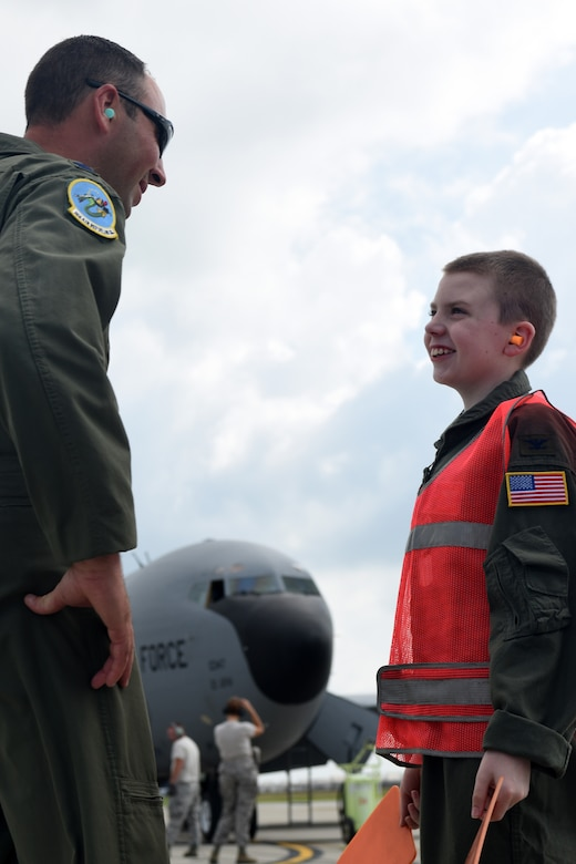 U.S. Air Force Capt. Jacob Allen, a pilot with the 121st Air Refueling Wing, talks with Pilot for a Day, Jake Sprowl, a 12-year-old from Springfield, Ohio, Aug. 11, 2015 at Rickenbacker Air National Guard Base. Sprowl and his family spent the day with Airmen of the 121st Air Refueling Wing, touring the base and learning about the missions of the various squadrons. (U.S. Air National Guard photo by Airman Ashley Williams/Released)