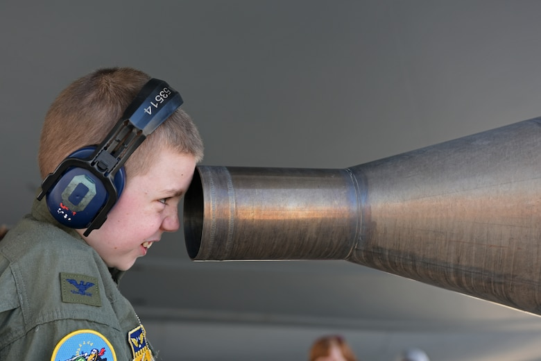 Jake Sprowl, a 12-year-old from Springfield, Ohio, peers into the rear of the engine of a KC-135R Stratotanker Aug. 11, 2015 at Rickenbacker Air National Guard Base. Sprowl was the honorary Pilot for a Day and spent the day with Airmen of the 121st Air Refueling Wing, touring the base and learning about the missions of the various squadrons. (U.S. Air National Guard photo by Airman Ashley Williams/Released)