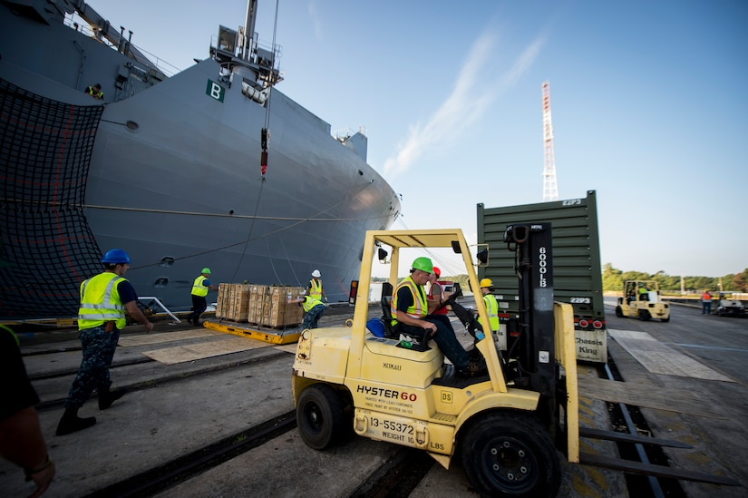 Sailors, Marines and civilians with the Navy Munitions Command Unit Charleston and Marine Corps Systems Command upload cargo to the USNS Lewis and Clark (T-AKE-1) March, 25, 2015, at Naval Weapons Station Wharf Alpha, Charleston, S.C. The Lewis and Clark is a replenishment naval vessel. In 2012, USNS Lewis and Clark became one of 12 ships that comprise the United States Marine Corps Maritime Prepositioning Program. Prepositioning ships provides quick and efficient movement of military equipment/supplies between operating areas without reliance on other nations' transportation networks. These ships assure U.S. regional combatant commanders they will have what they need to quickly respond in a crisis - anywhere, anytime. (U.S. Air Force photo/Airman 1st Class Clayton Cupit)