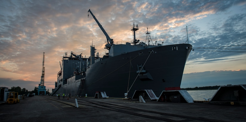 The USNS Lewis and Clark (T-AKE-1) waits for a cargo upload while docked March, 25, 2015, at Naval Weapons Station Wharf Alpha, Charleston, S.C. The Lewis and Clark is a replenishment naval vessel. In 2012, USNS Lewis and Clark became one of 12 ships that comprise the United States Marine Corps Maritime Prepositioning Program. Prepositioning ships provides quick and efficient movement of military equipment/supplies between operating areas without reliance on other nations' transportation networks. These ships assure U.S. regional combatant commanders they will have what they need to quickly respond in a crisis - anywhere, anytime. (U.S. Air Force photo/Airman 1st Class Clayton Cupit)