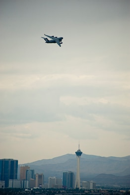 A C-17 Globemaster III assigned to the 437th Airlift Wing, Charleston Air Force Base, S.C., flies to the Nevada Test and Training Range during Red Flag 15-4, Aug. 25, 2015. With a range of over 2,500 miles, the C-17 is capable of carrying 102 troops or paratroopers or 170,900 pounds of cargo at a service ceiling of 45,000 feet. (U.S. Air Force photo by Senior Airman Thomas Spangler)