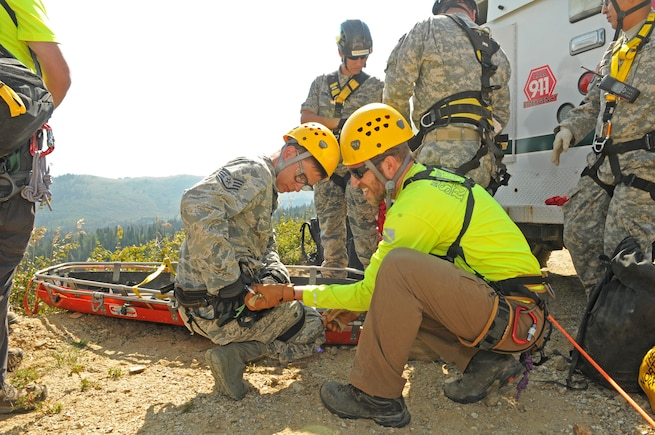 Utah Army and Air National Guard members participate in a multi-agency medevac training scenario with Davis County Search and Rescue near the Beaver Ponds in Utah's Farmington Canyon on Aug. 16, 2015. (U.S. Air National Guard photo by Tech. Sgt. Amber Monio/Released)