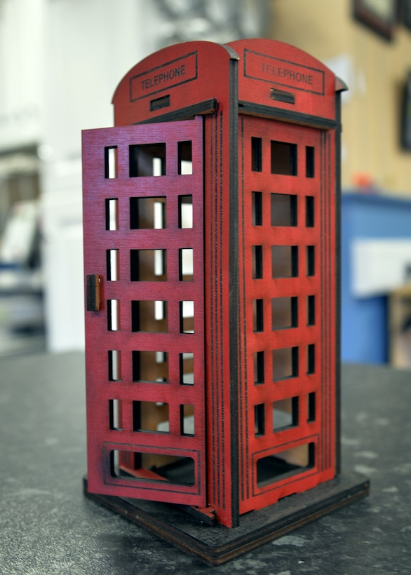 A wooden British telephone box is just one of many items created by the 100th Force Support Squadron Arts and Crafts facility. Customers can personalize the phone box in several ways, including with an engraved plaque or coin inset into the base or top. The arts and crafts staff can create items using a laser machine. (U.S. Air Force photo by Karen Abeyasekere/Released)