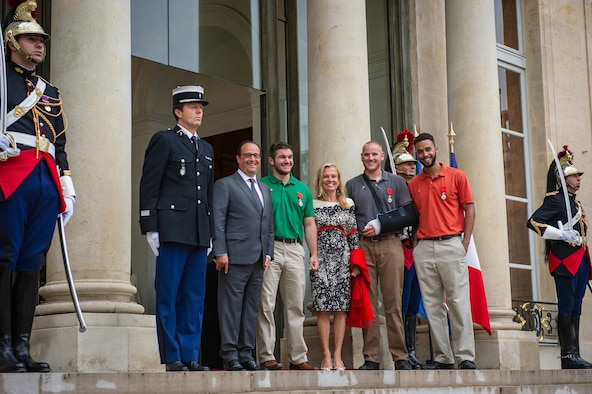 French President Fran??ois Hollande stops for a photo with Airman 1st Class Spencer Stone, Aleksander Skarlatos, Anthony Sadler and Jane Hartley, U.S. ambassador to France, after a Legion of Honor ceremony at the ??lys??e in Paris Aug. 24, 2015. Stone was on vacation with his childhood friends, Aleksander Skarlatos and Anthony Sadler, when an armed gunman entered their train carrying an assault rifle, a handgun and a box cutter. The three friends, with the help of a British passenger, subdued the gunman after his rifle jammed. Stone???s medical training prepared him to begin treating wounded passengers while waiting for the authorities to arrive. Stone is an ambulance service technician with the 65th Medical Operations Squadron stationed at Lajes Field, Azores. (U.S. Air Force photo/Tech. Sgt. Ryan Crane)