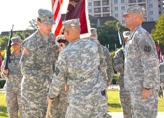 Far right) Outgoing commander Col. Jerrod Killian watches as 32nd Medical Brigade commander Col. Jack Davis (center) presents the 264th Medical Battalion colors to incoming commander Lt. Col. Werner Barden at the U.S. Army Medical Department Museum courtyard at Fort Sam Houston Aug 4.