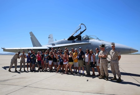 Marines and Educators with Recruiting Station Portland pose with an F-18 Hornet at Marine Corps Air Station Miramar, during the 2015 Educators Workshop. These teachers, coaches and counselors got to experience some of the physical challenges of Marine Corps basic training and talk to Marines operating in their occupational specialty. The educators saw many of the installation's services provided to the Marines including the Education Center, Moral Welfare Recreation Center and Chow Hall.