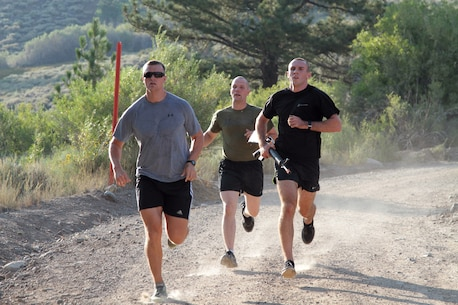 "Captain Joshua Dewalt (left) runs with officer candidates during military training at Marine Corps Mountain Warfare Training Center here, Aug. 22, 2015. Officer candidates from Recruiting Station Sacramento as part of ""Warrior Weekend."" The candidates hiked steep trails, competed in team exercises, and received classes as part of preparation for Officer Candidate School in Quantico, Va."