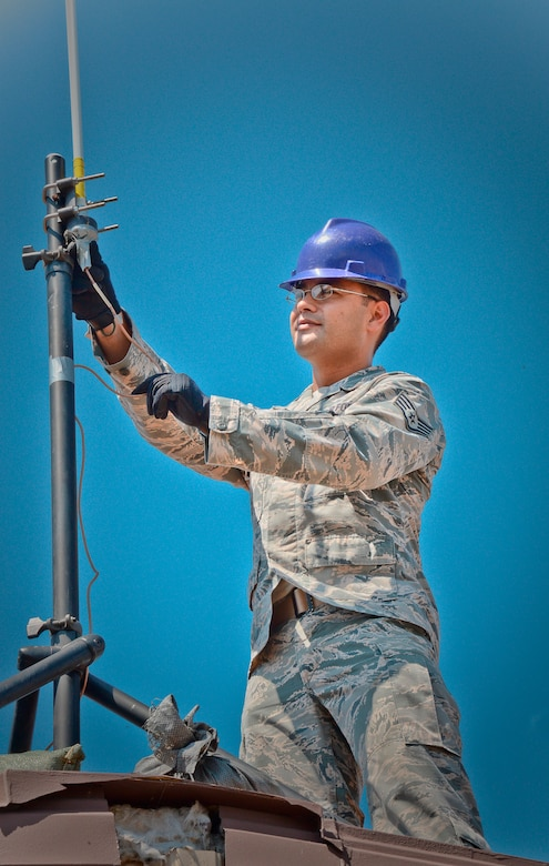 Staff Sgt. Roger Toliver, 644th Combat Communications Squadron radio frequency transmissions supervisor, performs a preventative-maintenance inspection on an antenna to ensure reliable radio communications are maintained Aug. 27, 2015 on Suwon Air Base, Republic of Korea. The 644th CBCS is in place at Suwon AB from Andersen Air Force Base, Guam, to help set up and maintain temporary communications to support and enable approximately 1,500 sorties during the displacement of Osan Air Base's assets and personnel. (U.S. Air Force photo/Tech. Sgt. Travis Edwards)