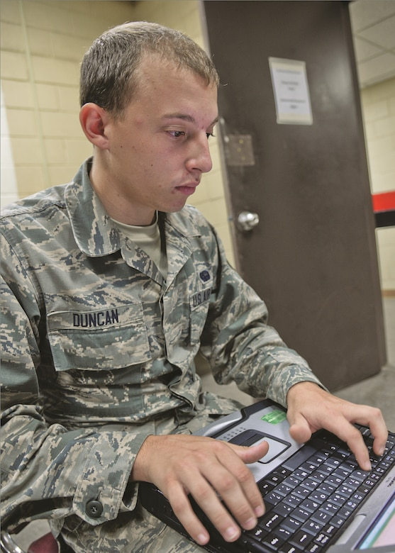 Airman 1st Class Lucas Duncan, 644th Combat Communications Squadron radio frequency transmissions apprentice, uses a laptop to monitor and control updates to wireless Air Force communications assets Aug 27, 2015 on Suwon Air Base, Republic of Korea. The 15-Airman team from the 644th CBCS is in place at Suwon AB from Andersen Air Force Base, Guam, to help set up and maintain temporary communications to connect approximately 200 devices and 700 displaced Osan Air Base Airmen. (U.S. Air Force photo/Tech. Sgt. Travis Edwards)