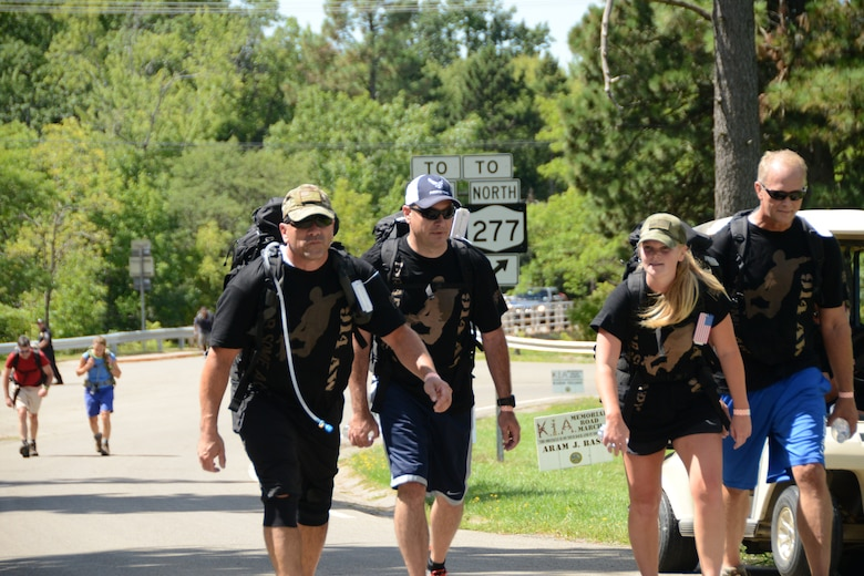 Senior Master Sgt. Steve Brown, Chief Master Sgt. Clint Ronan, Master Sgt. Hillary Harter and Col. Steven Parker participate in the KIA Memorial Road March at Chestnut Ridge State Park, Orchard Park, N.Y. August 22, 2015.  Members of the 914th Airlift Wing participated in this 10K marching event carrying canned goods which were donated to local veteran organizations; all this in memory of Western New York veterans killed during the Global War on Terror.  (U.S. Air Force photo by Tech. Sgt. Andrew Caya)