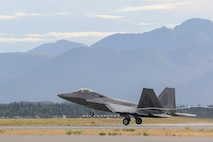 An F-22 Raptor assigned to the 90th Fighter Squadron takes off from Joint Base Elmendorf-Richardson, Alaska, Aug. 14, 2015., during Red Flag-Alaska. RF-A is a series of Pacific Air Forces commander-directed training exercises for U.S. and international forces to provide joint offensive, counter-air, interdiction, close air support, and large force employment in a simulated combat environment. (U.S. Air Force photo/Alejandro Pena)