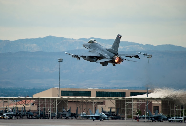 An F-16 Fighting Falcon assigned to the 457th Fighter Squadron at Naval Air Station Fort Worth Joint Reserve Base, Texas, takes off during Red Flag 15-4 at Nellis Air Force Base, Nev., Aug. 25, 2015. Active-duty, Guard and Reserve members from the Army, Navy, Marines and Air Force, along with air forces from other countries, participated in the exercise. (U.S. Air Force photo/Senior Airman Thomas Spangler)
