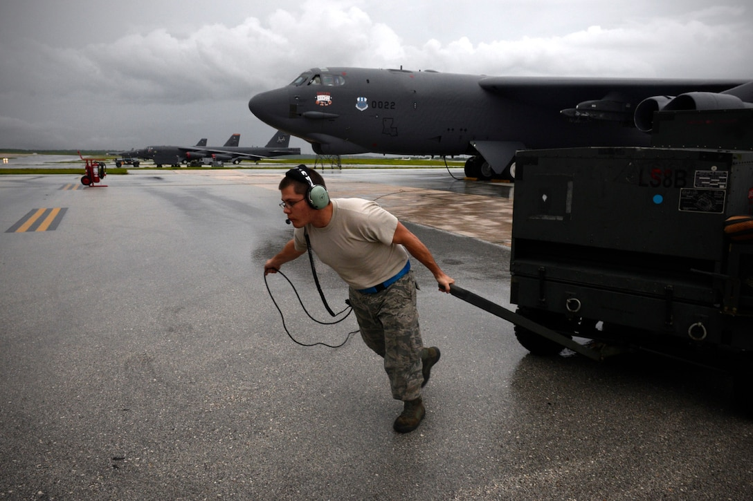 Staff Sgt. Stephen Cole, a B-52 Stratofortress crew chief assigned to the 20th Expeditionary Aircraft Maintenance Squadron, moves ground equipment during aircraft launch operations Aug. 22, 2015, at Andersen Air Force Base, Guam. Bomber crews with the 20th Expeditionary Bomb Squadron are part of U.S. Pacific Command's continuous bomber presence and support ongoing operations in the Indo-Asia-Pacific region. (U.S. Air Force photo/Staff Sgt. Alexander W. Riedel)