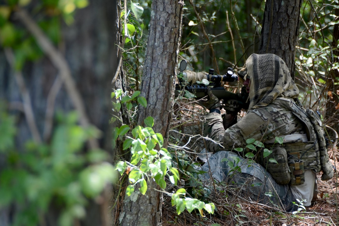 Senior Master Sgt. Larry Smith, a 169th Force Support Squadron base training manager and reserve deputy with the Richland County Sheriff's Department, acts as a sniper during an active shooter exercise at McEntire Joint National Guard Base, S.C., Aug. 20, 2015. The exercise scenario involved an incident where armed individuals attacked entrance points on base. Due to limited personnel on duty, the Richland County Sheriff's Department responded to assist with K-9, SWAT and explosive ordnance disposal units. (South Carolina Air National Guard photo/Tech. Sgt. Caycee Watson)