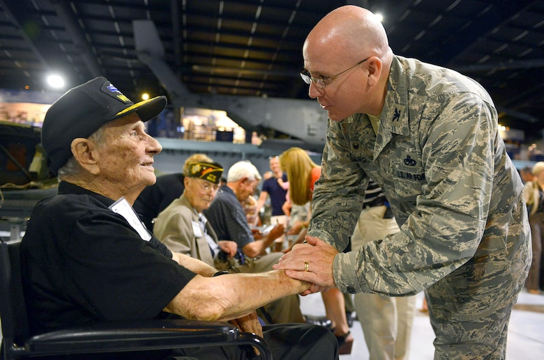 Col. Jeffrey King, the 78th Air Base Wing commander, greets John Barrett, an Army veteran, during a reception at the Museum of Aviation in Warner Robins, Ga., Aug. 21, 2015. Barrett, a private first class during World War II, received a Purple Heart and Silver Star after being wounded in action and taken as a prisoner of war. The reception honored veterans who served aboard B-17 Flying Fortresses and celebrated the arrival of a B-17 that will be displayed at the museum. (U.S. Air Force photo/Tommie Horton)