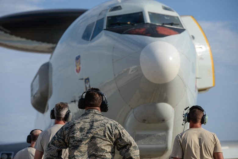 Maintenance Airmen from the 513th Air Control Group wait for an E-3C Sentry (AWACS) to complete its shutdown procedures after completing a training mission at Naval Air Station North Island in Coronado, Calif., Aug. 24, 2015. The 513th maintenance reservists accompany every off-station training mission to provide routine checks as well as repairs, if needed. (U.S. Air Force photo/Staff Sgt. Caleb Wanzer)